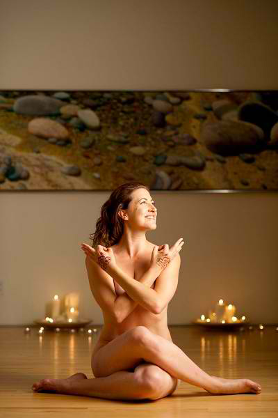 a woman practicing nude exercises