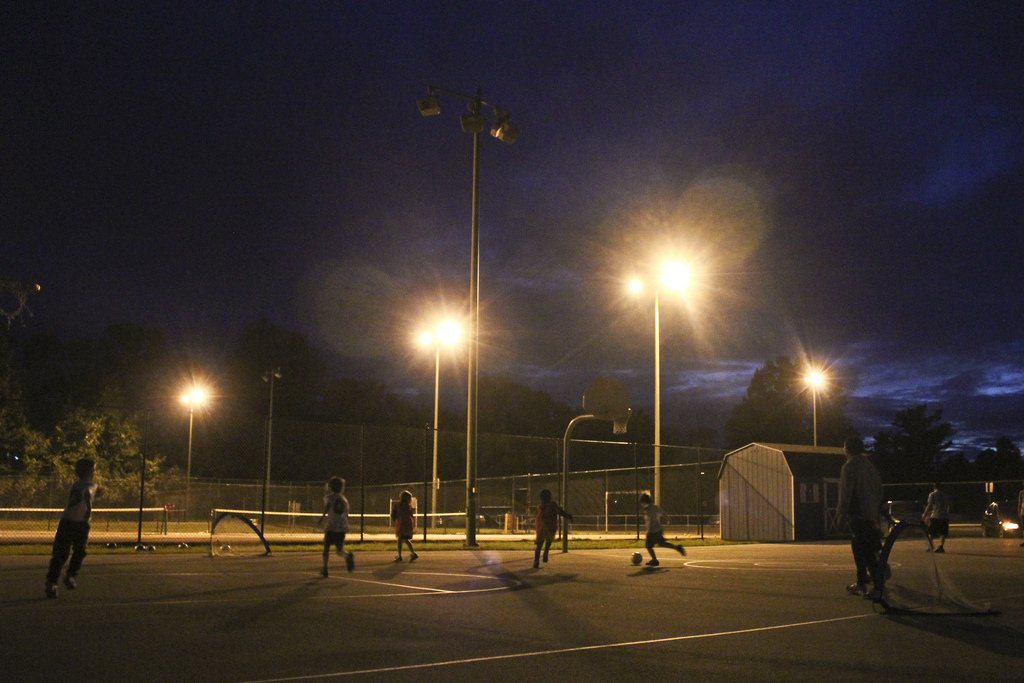 Professionals playing a friendly futsal match after work.