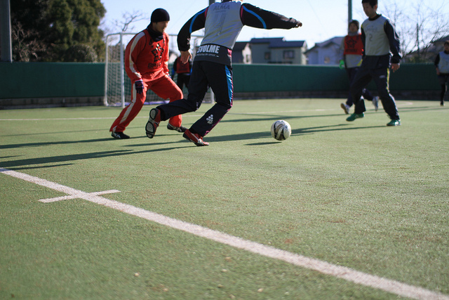 Young adult students playing futsal.
