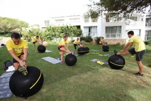 People exercising outdoors with Technogym's wellness balls
