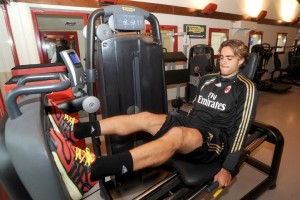 A football player using Technogym's Selection line to strengthen his leg muscle.