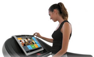 A fitness buff using Technogym's modern UNITY™ technology.