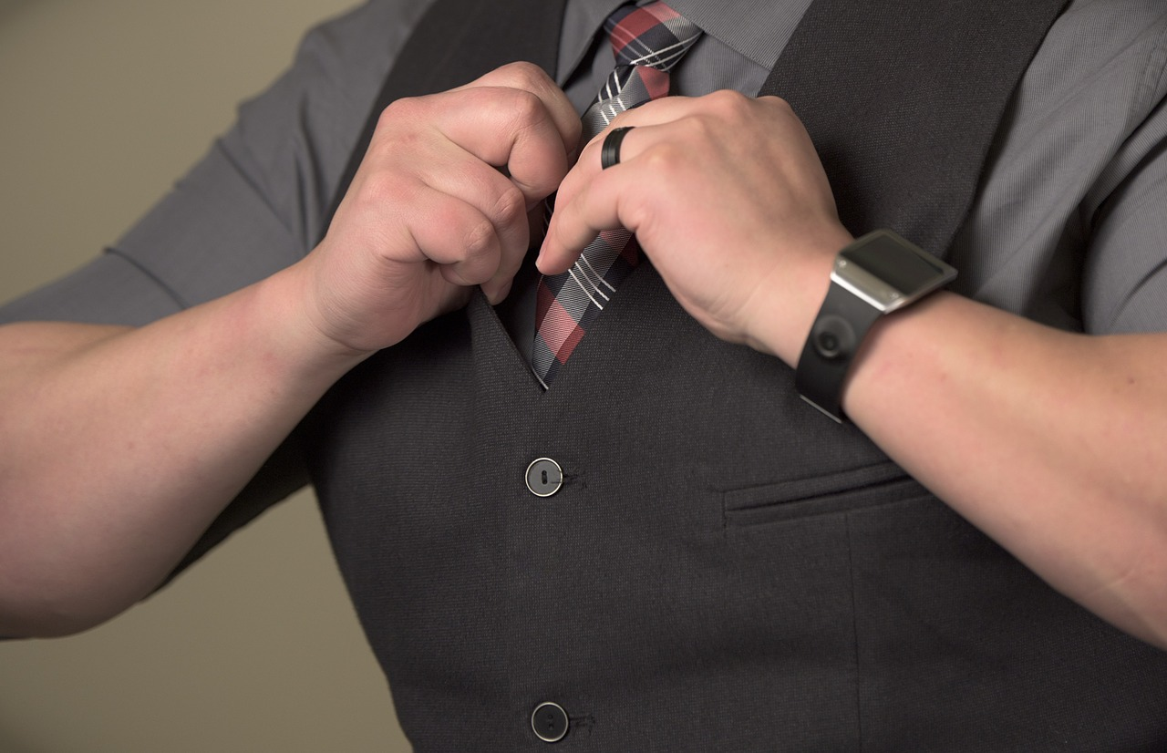 Businessman fixing his tie
