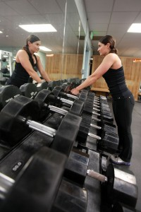 woman in gym with weights
